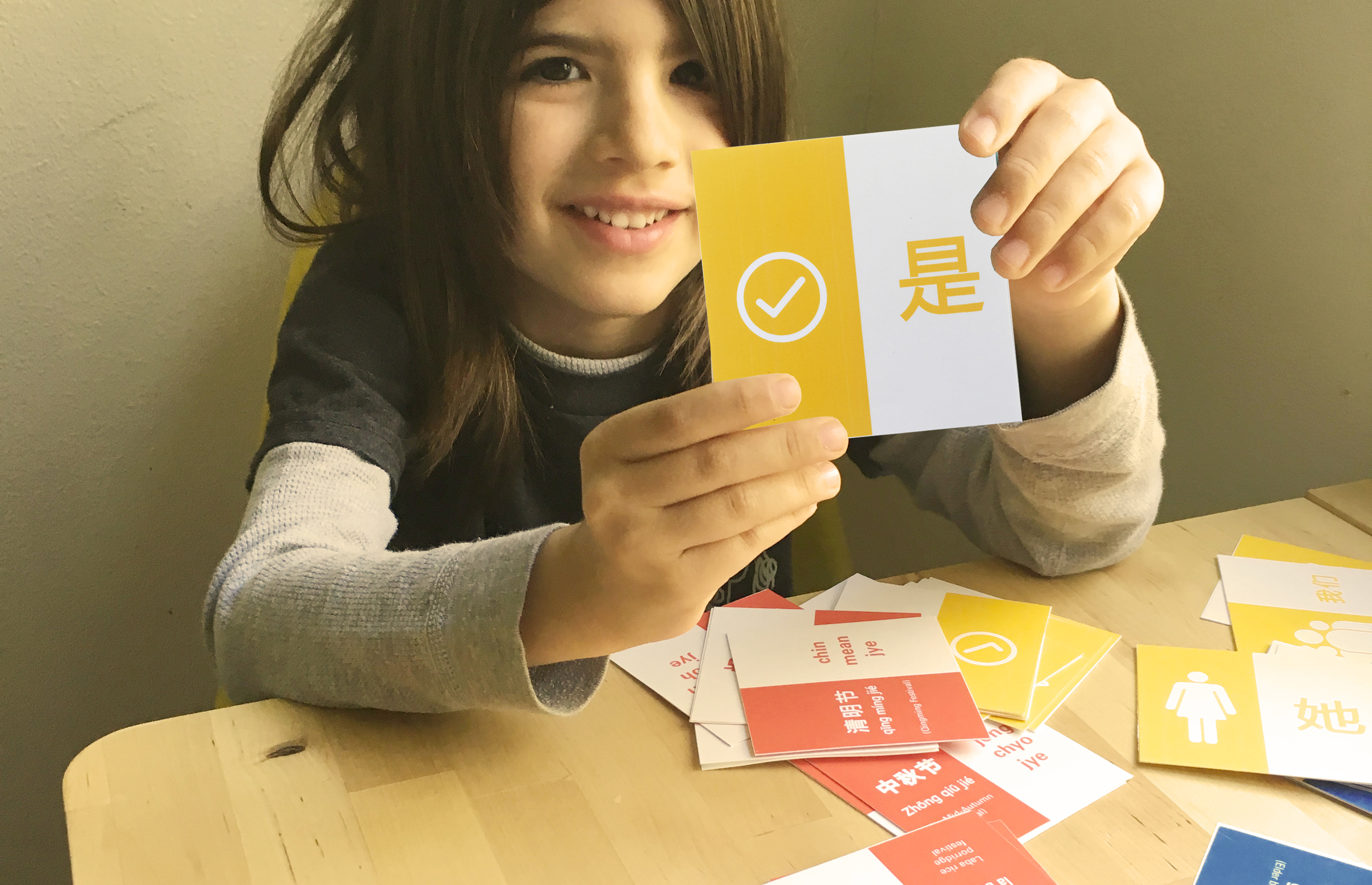 kid holding card